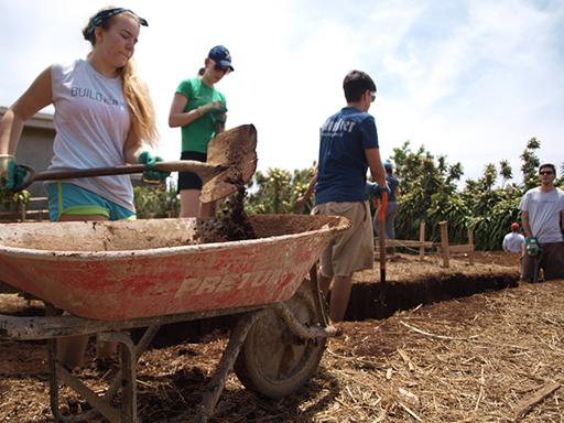Construction volunteer shoveling concrete in Costa Rica