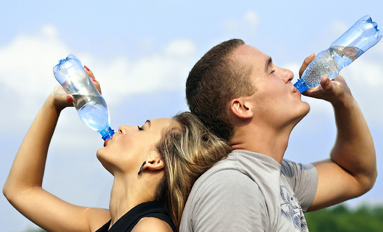 People drinking water in a bottle