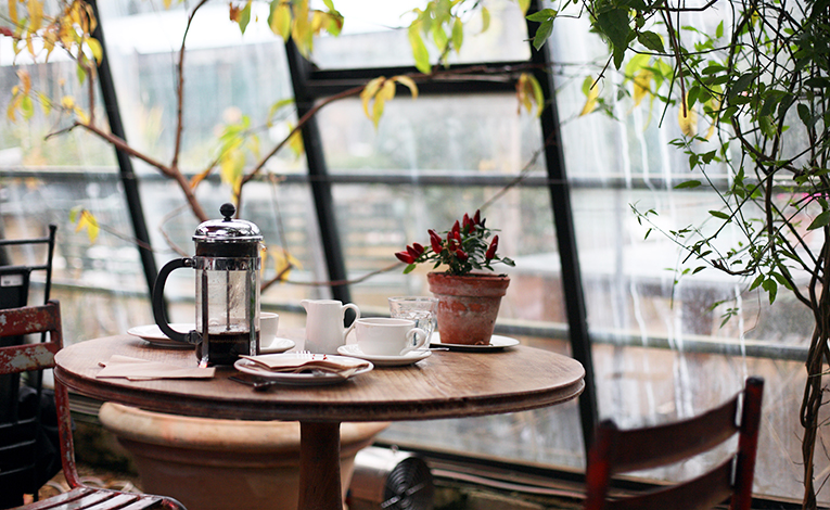 Table in a cafe with a French press